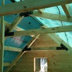 trusses being bolted together with gusset plates, log home construction, Timberhaven, custom built log homes, kiln dried, laminated