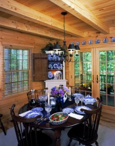 Cozy log cabin dining room, liberty log cabin home, log homes, log cabins, engineered logs, Timberhaven, Timberhaven Log & Timber Homes, single story homes, summer feature home, log cabin home
