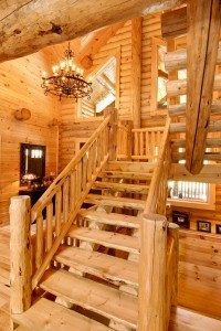 Half log handcrafted stair systems, custom stairs in log home, stair systems, wooden stair systems, custom stair systems, custom stairs, wooden stairs, Timberhaven stair options