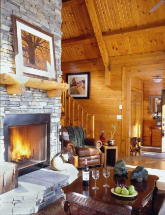 Massive Stone Fireplace In Log Home