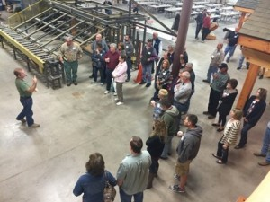 group looking at speaker, construction seminar, laminated logs, engineered logs, lamination process, log homes, timber frame homes, Timberhaven