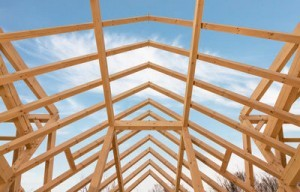 timber frame roof under construction, hurricanes pushing pricing, log homes, log cabins, timber frame homes, laminated logs, engineered logs, floor plan designs, kiln dried logs, log homes in Pennsylvania, Timberhaven Log Homes, Timberhaven Log & Timber Homes