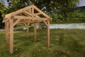 timber frame pavilion by a pond, product display areas, timber frame display, timber frame pavilion, timber frame outdoor wooden structures