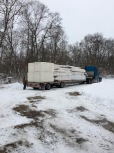tractor trailer truck loaded with materials, built in the winter, log home winter, building a log home in the winter, building a timber frame home in the winter, Timberhaven