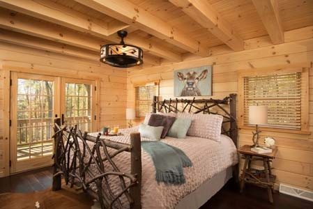 Log Cabin Master Bedroom Features Private Balcony