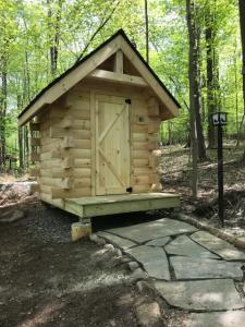 logo cabin outhouse, log cabin loo, log outhouse, log loo, outhouse off the grid, unique outhouse, unique log cabin, log cabin home, log cabins, log homes, timber frame homes, Engineered Logs, Timberhaven Log & Timber Homes
