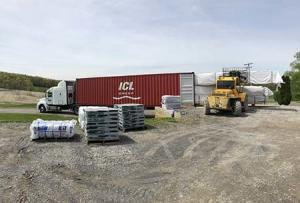 materials being loaded onto a sea container, log home package, international distribution, international delivery, log home delivery, delivery day, netherlands log home, kiln dried, heat treated, Timberhaven