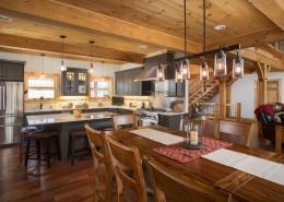 Open timber frame dining and kitchen area