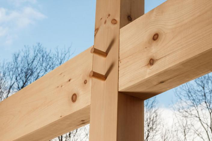 Intersection of timber frame members secured with pegs