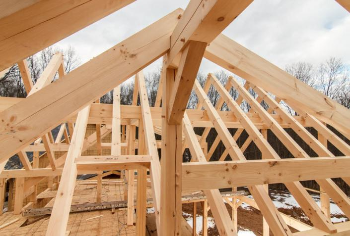 Timber frame under construction roof
