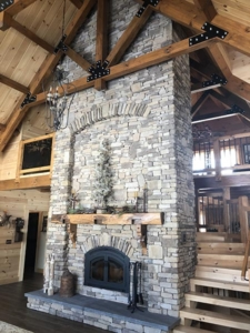 fireplace and King post truss, farmhouse inspired log home, log home, log home living, log home great room, cathedral ceilingTimberhaven, kiln dried