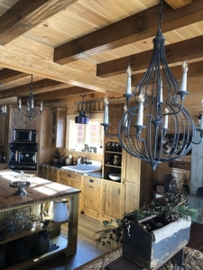kitchen cabinets and lighting, farmhouse inspired log home, log home, log home living, log home kitchen, Timberhaven, kiln dried