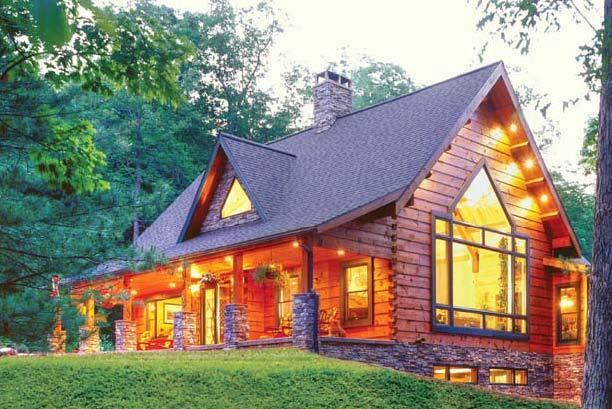 beautiful log home with lights on, informative webinar, educational event, log home, log homes, log home living, timber homes, Timberhaven,