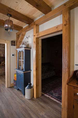 timber frame entry way with exposed beams, timber accents, timber frame, timber frame accents, hybrid homes, Timberhaven, engineered timbers, kiln dried