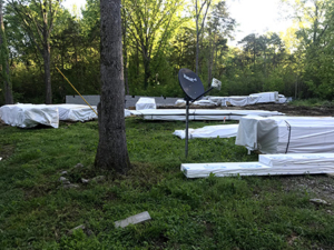 packs of material stacked around lawn, New Model Log Home Delivery, log home delivery, delivery day, log homes, Timberhaven, local reps, model home in TN