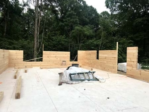 log walls and sub floor, log stacking, under construction, model home, log home, Timberhaven
