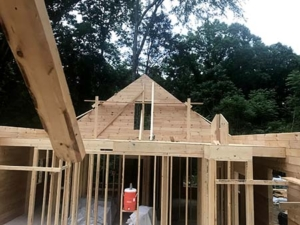 log home being built, new model log home under construction, log, log homes, under construction