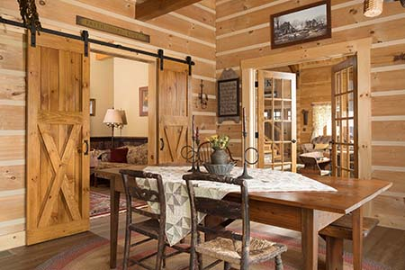 Log Home Sun Room is Open and Bright