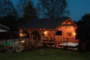 timber frame pavilion with pool and fence, custom feature, timber structures, Timberhaven, outdoor living, outdoor living spaces