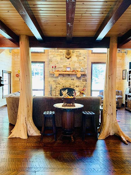 Character trees in log home entryway.
