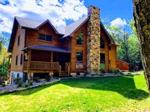 two story log home with windows and fireplace, log home, log cabin, log cabin home, Timberhaven, made to last a lifetime