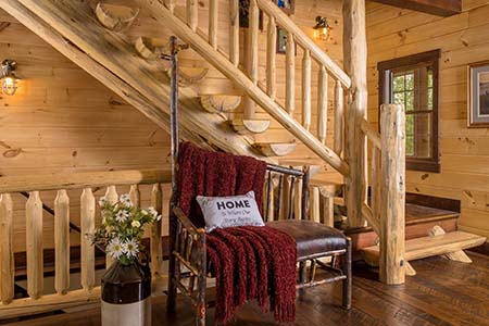 Half log stair system in foyer