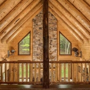 Round rafters in log home loft.