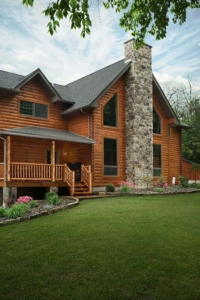 log homoe with stone chimney, log home with stone in the woods, mountain log home, custom log home, Timberhaven, engineered logs, log homes in PA, kiln dried, custom home package