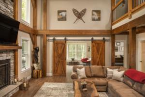 Timberframe frame and barn doors, timber frame home, timber frame living area, timber accents, Timberhaven