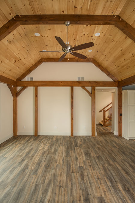 Gambrel style timber framing in great room.