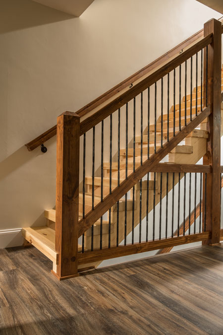 Custom stairs with wood-metal rail system.