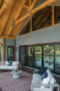 large porch with cathedral ceiling, timber trusses, lakehouse, modern touch of timber, timberhaven