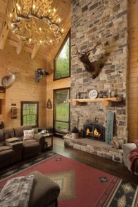 massive stone fireplace in great room, log home with stone in the woods, mountain log home, custom log home, Timberhaven, engineered logs, log homes in PA, kiln dried, custom home package